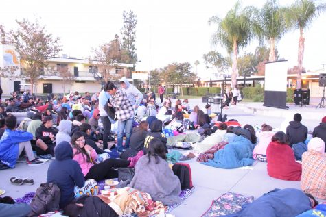 The Class of 2016 seniors gather in the quad early in the morning to watch a movie. Back then before the jumbotron in the squad, the ASB had to set up a screen in front of the steps of the quad for the movie to be projected there for students to watch. (Accolade File Photo)