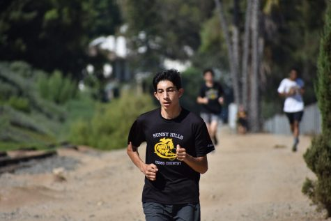 Senior Chris Sanchez finishes his run during practice near the train tracks near the Agriculture complex Aug. 29. Photo taken by Accolade photographer Paul Yasutake.