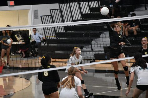 Middle blocker senior Marlena Martinez (right) jumps in the air to spike a ball during a 3-0 win against Bonita High School Sept. 10 at the Sunny Hills gym. Photo taken by Accolade photographer Paul Yasutake.