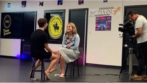 Dance Production team member sophomore David Burn (left) sits down for his first professional media interview Sept. 3 with Fox 11's Megan Colarossi, co-host of Good Morning LA. As the only male performer on Sunny Hills' Dance Production, Burn will be featured in Colarossi's