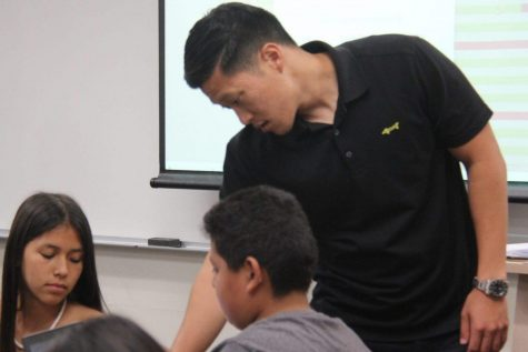 New math teacher and Sunny Hills alumnus Minhoh Han teaches his geometry students about specific equations that can be applied to different shapes on Sept. 4. Han (Class of 2009) joins 13 other instructors here who also graduated from this campus.  Photo taken by Accolade photo editor Megan Shin.