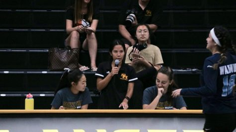 Girls volleyball frosh-soph coach Allison Wong (center) announces the roster for a varsity game against Walnut High School Aug. 22 in the Sunny Hills gym. Photo taken by Accolade reporter Andrew Ngo.