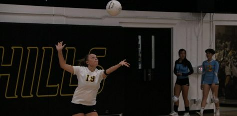 Defensive Specialist Calie Koehn serves the ball in the air while in her serving motion during a 3-0 loss to Walnut High School Aug. 22. (Photo taken by Accolade news editor Tyler Pak)
