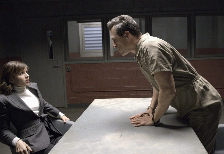 In the pilot episode that premiered Sept. 26, actress Katja Herbers plays forensic psychologist Kristen Bouchard (left), who reacts to a homicide suspect (Darren Pettie) during a jail-room meeting to determine whether he is actually possessed by a demon. Image used with permission from CBS Broadcasting ©2019. Photo by Jeff Neumann