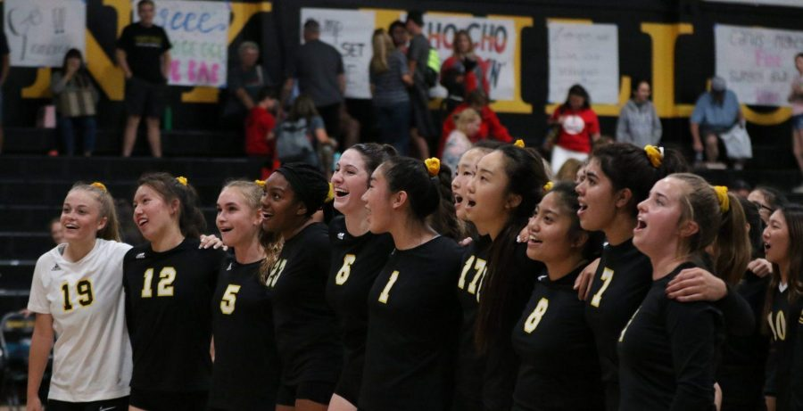 Members+of+the+girls+volleyball+team+band+together+while+singing+the+school%27s+alma+mater+following+their+final+home+Freeway+League+game+Oct.+14+against+Fullerton.+Photo+taken+by+Accolade+photographer+Paul+Yasutake