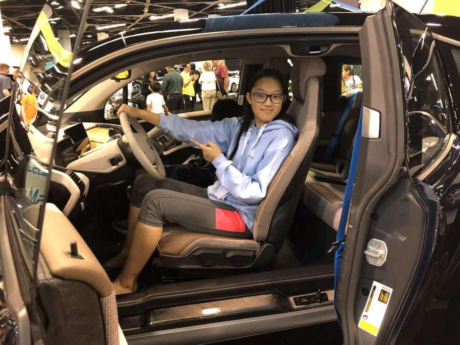 Accolade staff writer Hope Li sits in a 2018 BMW i3 Oct. 3 at the Orange County Auto Show at the Anaheim Convention Center. Photo taken by Accolade adviser Tommy Li