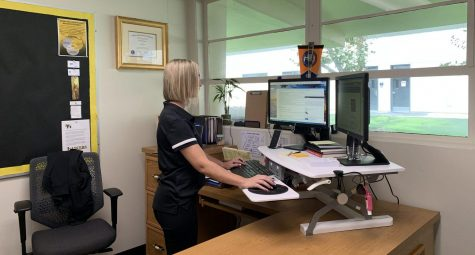 New assistant principal Melissa Stinson works in her office dealing with tasks given to her at her new position. Photo taken by Paul Yasutake.