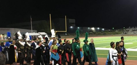 Band leaders from each school in the competition march on the field before receiving their awards at Sierra Vista High School Oct. 26. Sunny Hills is the third team from the right. Image reprinted with permission from Brian Milian