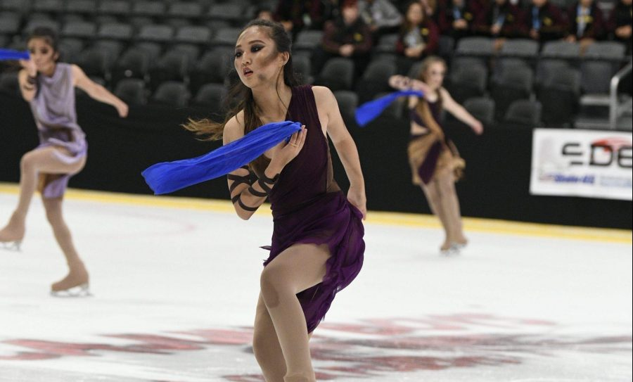 Junior Irene Lee performs in her routine during the 2019 National Theater on Ice competition in Alabama June 28. She is wearing dark markup as part of the routine. Photo reprinted with permission from Kayla Heo.