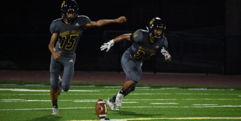 Freshman Mathias Brown (left) gets ready for one of his kickoffs during the Sept. 6 game against Irvine High School. Photo taken by Accolade photographer Paul Yasutake.
