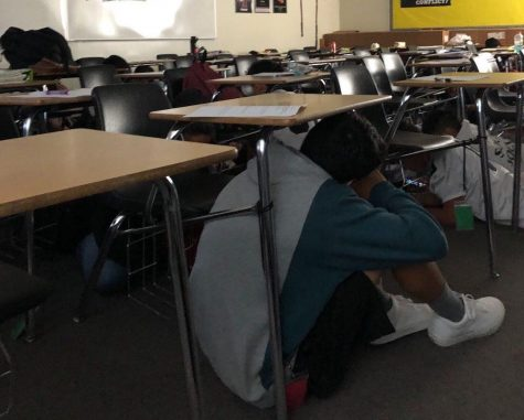 Freshman English teacher Jennifer Kim's students hide under their desks in Room 188 after hearing about the lockdown announcement during second period Oct. 24. Image posted with permission from Jennifer Kim