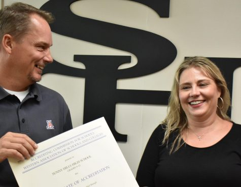 Principal Allen Whitten (left) shows the WASC certificate to English teacher Suzanne Boxdorfer, who was the WASC coordinator in charge of producing a self-study report for the visiting team in March of last semester. The document concluded that  Sunny Hills High School's accreditation is valid until June 30, 2025. Photo by Accolade photographer Paul Yasutake