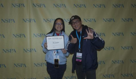 Accolade staff writer junior Hope Li (left) holds the Best of Show certificate from the National Scholastic Press Association while adviser Tommy Li holds up six fingers signifying the placement. The Nov. 23 awards ceremony was held in Washington, D.C., and The Accolade's first issue of the school year earned recognition for placing in the Top 10 nationally.