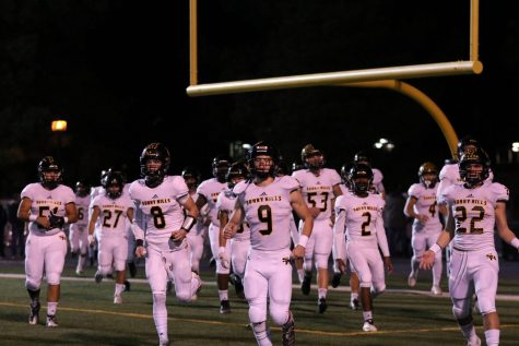 Linebacker junior Carson Irons (center) leads the Lancers on to the Trabuco Hills High School field in Mission Viejo during the Nov. 22 CIF Southern Section Division 8 semifinal game against the Mustangs. Irons made the game-saving interception off a tipped ball at the one-yard line with less than seven seconds left in the game. Photo taken by Accolade photographer Paul Yasutake