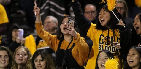 Then-junior Vivian Tran cheers on the Lancer football team at Trabuco Hills High School Nov. 23. It's unclear if fans will be allowed to watch games this season.