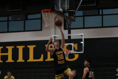 Senior guard Adam Reuter goes up for a layup during practice in the Sunny Hills gym Nov. 14. Photo taken by Accolade photographer Paul Yasutake