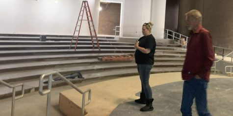 Theater teacher Amanda Gieser (left) and the site construction project manager survey the new stage extension during a recent inspection of the PAC, which has been closed since May for remodeling. Posted with permission from Melissa Stinson.