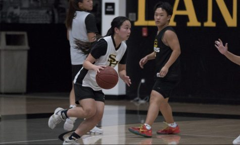 Shooting guard and small forward senior Rachel Kim drives into the lane while in a scrimmage against team assistants and other girls basketball players at the Sunny Hills gym Nov. 14. Photo taken by Accolade photographer Paul Yasutake
