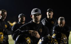 Head Coach Peter Karavedas speaks to the football team following the team's 42-21 loss to Bakersfield Christian in the CIF State Division 3-A SoCal Regional game at Bakersfield Christian High School stadium Dec. 14. Photo taken by Accolade photographer Paul Yasutake