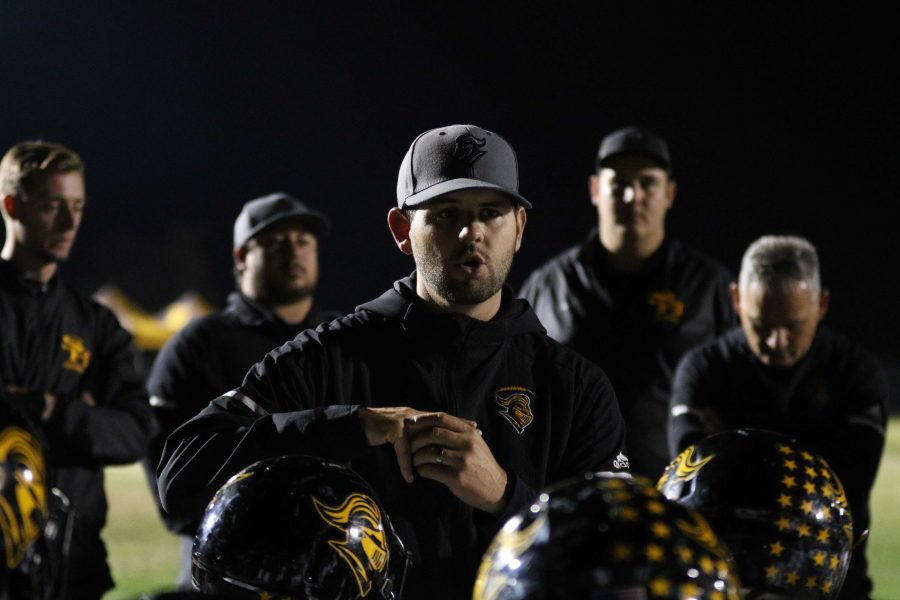 Head+Coach+Peter+Karavedas+speaks+to+the+football+team+following+the+team%27s+42-21+loss+to+Bakersfield+Christian+in+the+CIF+State+Division+3-A+SoCal+Regional+game+at+Bakersfield+Christian+High+School+stadium+Dec.+14.+Photo+taken+by+Accolade+photographer+Paul+Yasutake