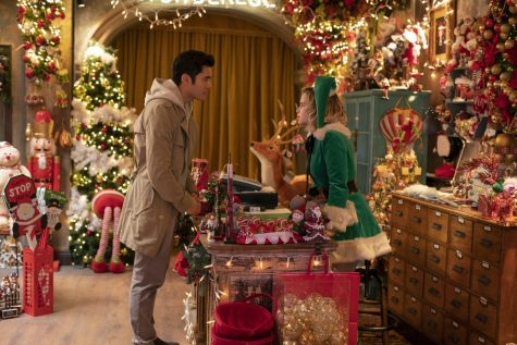 Sparks fly as Tom (Henry Golding) and Kate (Emilia Clarke) chatter across the counter in the Christmas boutique that Kate works at in the holiday film,
