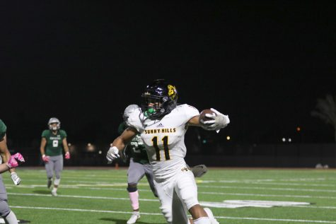 Wide receiver and defensive back senior Wilson Cal runs an interception back during a 49-8 win against Buena Park Oct. 11 at Buena Park High School stadium. Photo taken by Accolade photographer Paul Yasutake