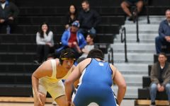 Senior Andrew Park (left) stares down Juan Sanabria during their 220-pound weight class bout Jan. 15 in the Sunny Hills gym. Park pinned Sanabria in the second period to put the Lancers ahead 41-15 with just four matches remaining. Photo taken by Accolade photographer Paul Yasutake