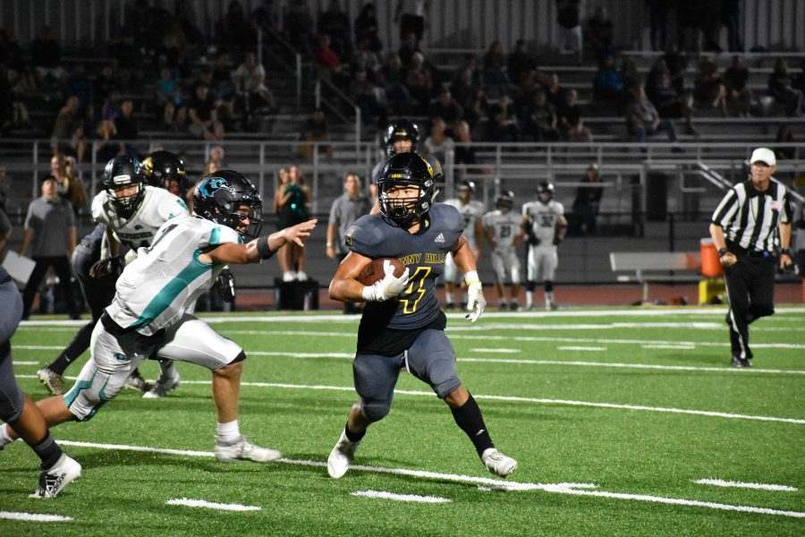 Running+back+and+defensive+back+senior+Jun+Ahn+carries+the+football+in+the+red+zone+during+the+season+opener+against+Aliso+Niguel+Aug.+30+at+Buena+Park+High+School+stadium.+Ahn+has+committed+to+playing+Division+1+football+at+Drake+University+in+Des+Moines%2C+Iowa%2C+where+he+will+major+in+kinesiology.+Photo+taken+by+Accolade+photographer+Paul+Yasutake