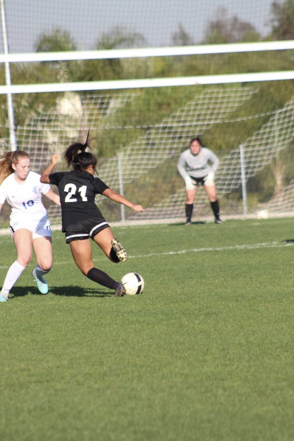 Midfielder senior Meghan Legayada attempts to fires the ball toward the goal during a 5-0 blowout against La Habra Jan. 29 at the Sunny Hills field. Photo taken by Accolade photographer Brianna Zafra
