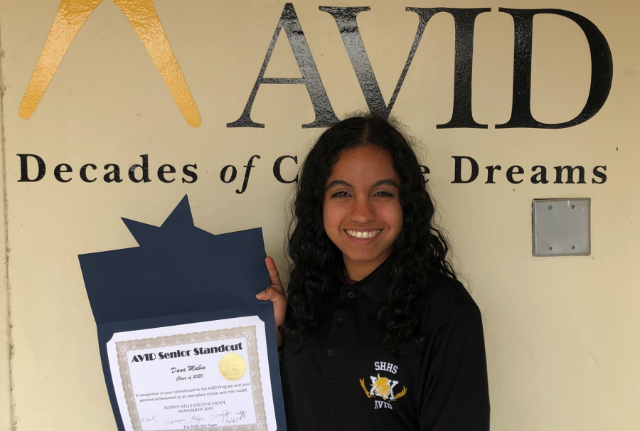 Senior Dana Mabin holds up the certificate she received back in November for being this school year's AVID Senior Standout. Mabin will be recognized April 20 at the University of California at Irvine's Barclay Theater. That's also the same day when she'll find out whether she will be awarded up to $24,000 for the Orange County AVID scholarship and up to $2,500 for the AVID Orange County Dollars scholarship. Image used with permission from Lori Larsen.