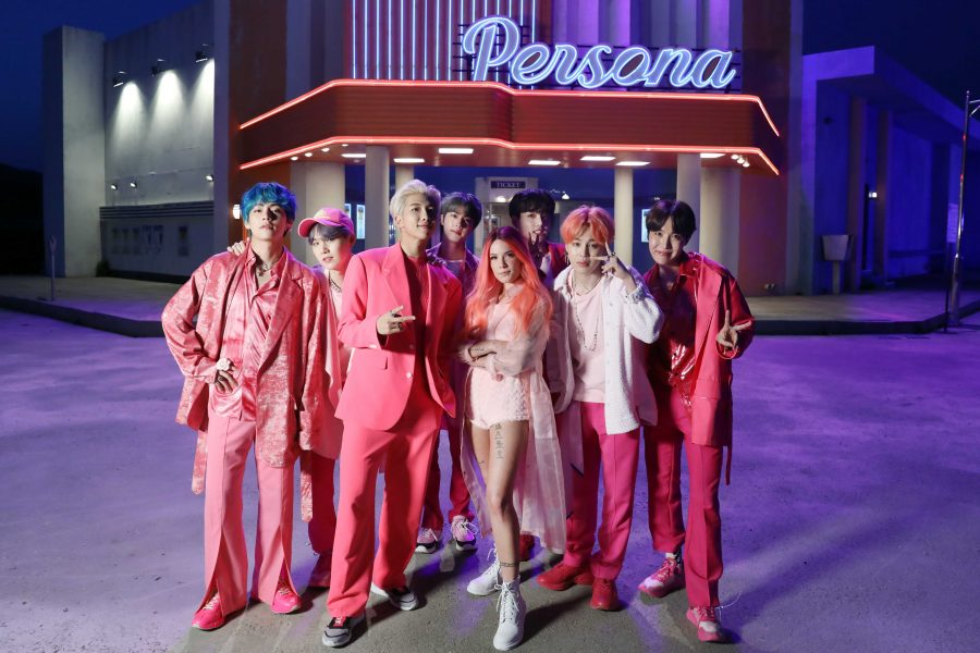 "BEHIND THE SCENES: Seven-member boy band BTS stands next to singer Halsey on their set for the music video for ""Boy With Luv,"" the lead single from the 2019 album Map of the Soul: Persona. Image reprinted with permission from Taesong Kim/image.net."