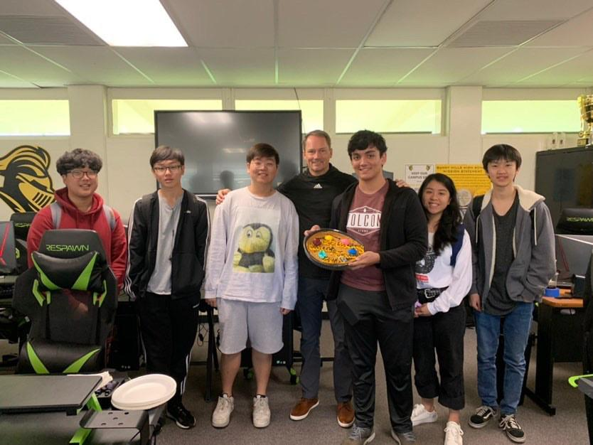 Members of the Sunny Hills League of Legends team celebrate with principal Allen Whitten and senior Serena Lee after their win over Eleanor Roosevelt in the PlayVS League final Jan. 29 in Room 44. Photo reprinted with permission from Sonya Joyce