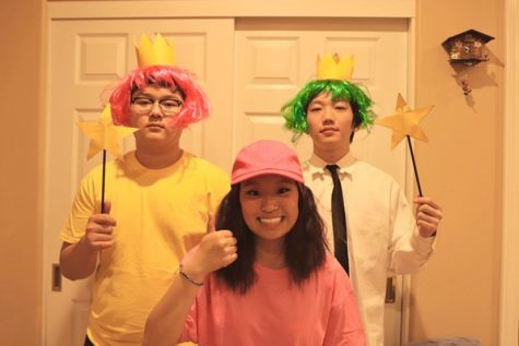 Junior Albert Chung (left) and senior Kenji Williams stand behind junior Carrie Cheng during their filming of Cheng's ASB campaign video. Cheng, who got the most votes for ASB treasurer March 13, was cosplaying as Timmy Turner, the protagonist of