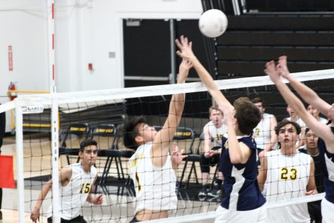 Senior Andrew Park (center) pushes the ball past Crean Lutheran defenders during a 3-1 loss to the Saints. The Feb. 20 game was the first ever Sunny Hills boys volleyball game. Now, the inaugural Freeway League boys volleyball season will have to be postponed to next year. Photo taken by Accolade photographer Brianna Zafra