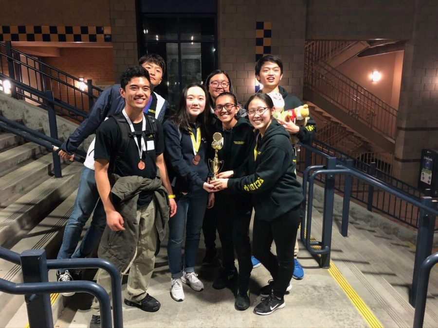 Co-captains+senior+Cecilia+Lee+%28center%29%2C+senior+Megan+Luo+%28bottom+right%29+and+senior+Samuel+Kho+%28top+right%29+join+some+of+their+Science+Olympiad+teammates+in+celebration+of+their+fourth-place+finish+at+the+Feb.+15+regional+competition+held+at+the+University+of+California%2C+Irvine.+Image+posted+with+permission+from+William+Kho.