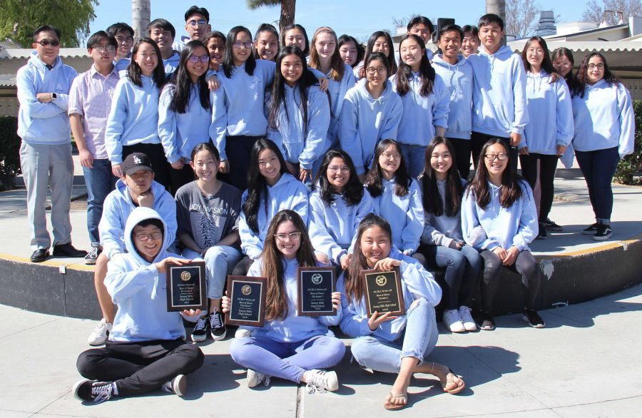 The+Accolade%27s+web+editor+senior+Alex+Park+%28left%2C+front+row%29%2C+editor-in-chief+senior+Michelle+Buckley+and+managing+editor+senior+Hannah+Yi+hold+up+Orange+County+Journalism+Education+Association+Best+of+Show+plaques+that+have+been+awarded+to+the+newspaper+for++the+past+four+years+as+part+of+an+annual+writeoff+contest.+Image+used+with+permission+from+Arya+Patel.