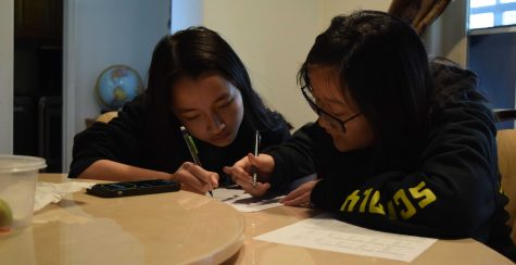 Freshman Maggie Kho (left) and junior Hannah Kim take a practice Codebusters test Feb. 14 at Kho's house after school, working on improving their decrypting skills together on a timed-bonus question to prepare for the regional Science Olympiad competition the next day. Though the Sunny Hills team made history in being the school's first squad to advance to the Southern California state tournament, the April 4 competition was canceled a month ago because of the COVID-19 pandemic. Image posted with permission from Anika Madan.