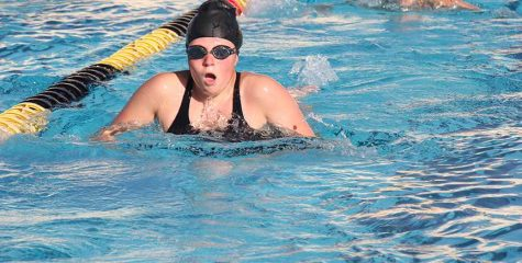 Sophomore Rachel Green takes a breath during her breast stroke practice in the Sunny Hills aquatics pool. Born deaf, Green relies on a light to go off as her starting signal when she competes in individual heats. Photo taken by Accolade photo editor Megan Shin