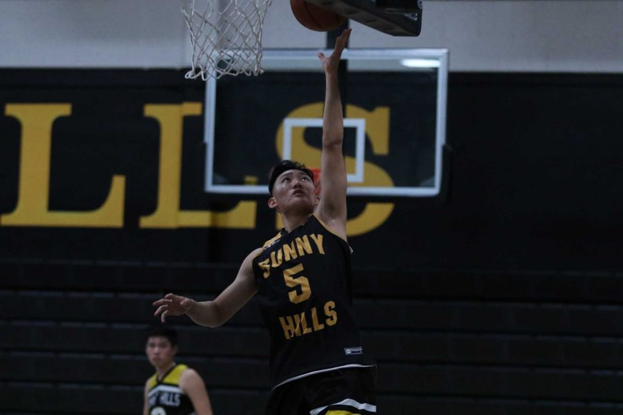 Senior Peter Park performs a layup during a practice on November 14. Park is one of the 12 valedictorians in the Class of 2020. Photo taken by Accolade photographer Paul Yasutake
