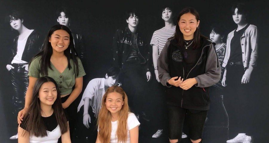 Sophomore Esther Oh (top row, left) and her Sunny Hills BTS ARMY friends get together in front of a banner of the band before the start of the May 2019 Love Yourself: Speak Yourself concert at the Rose Bowl in Pasadena.