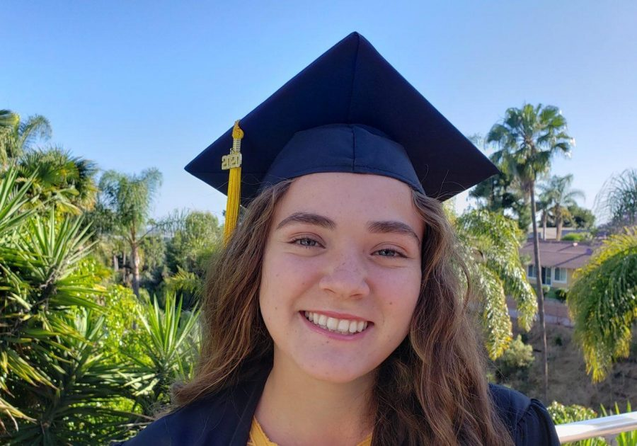 Senior Audrey Gass graduates as one of the 12 valedictorians for the class of 2020 at her house on May 20. Photo reprinted with permission from Audrey Gass