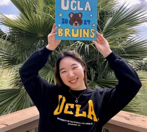 Senior Stacy Kim graduates as one of the 12 valedictorians for the class of 2020 at her house wearing UCLA merch. Photo reprinted with permission from Stacy Kim
