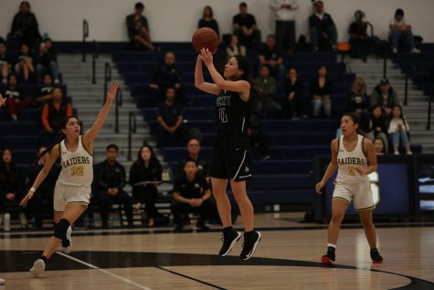 Guard senior Annika Johnson (center) shoots during a 42-35 win at Sonora on January 24. The win was Sunny Hills' first against the Raiders since the 2011-2012 season.