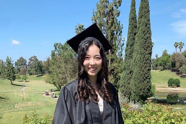 Senior Jenny Lee smiles for a picture in her neighborhood after filming a video for Sunny Hills High School's virtual graduation. Image posted with permission from Jenny Lee.