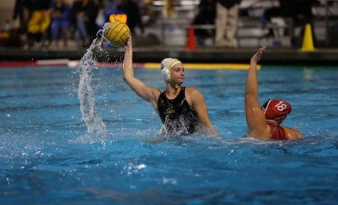 Kaya Hart (center) prepares to take a shot during a 16-5 victory over Fullerton at the Troy High School pool on Jan. 22.