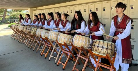 Wearing their performance outfits, some members of the Korean Culture Club practice with their buk drums March 2 after school on campus for Korean Culture Night. The March 21 event, which would have commemorated its 10th year, was canceled a week before because of the spread of the novel coronavirus. The thunderous sounds created by these instruments represent the South Korean nation, and the drummers' performance would have been the first one after intermission. Image posted with permission from Esther Lee.