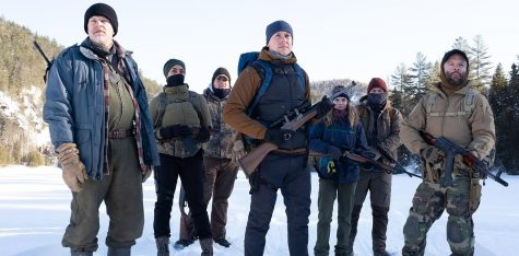 Locked and loaded, the survivalist trainees led by Alain (left) get ready for their next training exercise in Netflix's