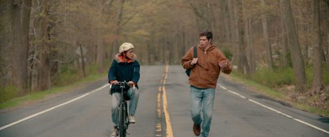 "In the new coming of age movie ""The Half of It,"" Peter stops Ellie on her bike ride home to propose an agreement on his love letter to Aster. Image posted with permission from Netflix."