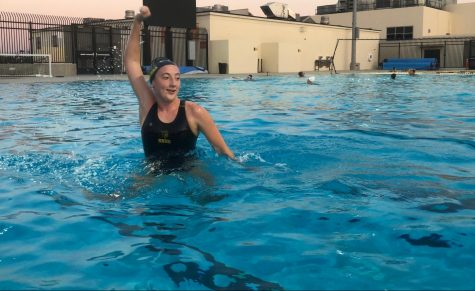 Although girls water polo utility player sophomore Sophia Smith cannot use a ball to pass to any of her teammates, she still winds up to practice her form Aug. 26 at Sunny Hills' aquatics center. Unlike other sports, those in the pool are permitted to exercise without wearing a mask because they are in the water.