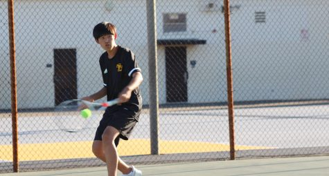 Boys tennis player rising sophomore Jaden Han returns the ball to his opponent in a March 3 match against Whitney. With the new CIF bylaw modifications, athletes will have the opportunity to participate in outside club activities and events during the regular school sports season.